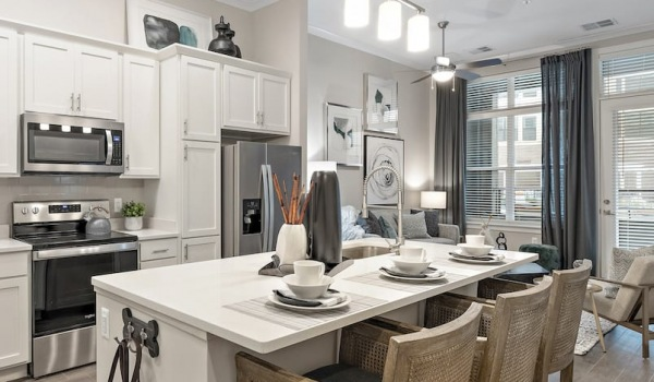 spacious and bright kitchen with an island and easy access to the living room