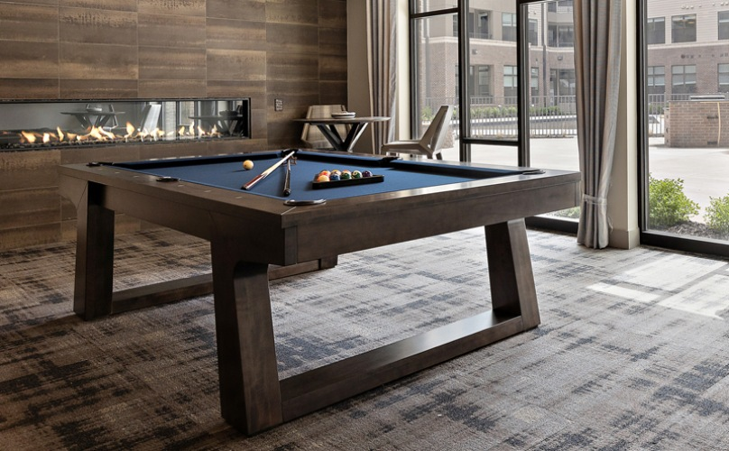 Gameroom with lounge seating and billiards